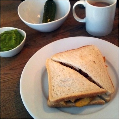 Chip butty, mushy peas, gherkin and a hot tea