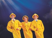Touring show cast members in Singing in the Rain