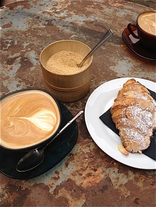 Coffee and almost croissant