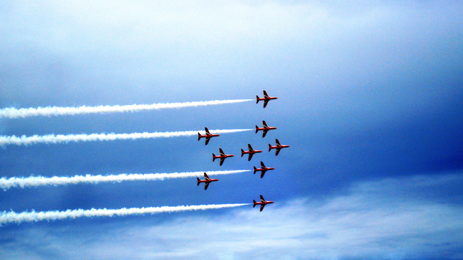 Red Arrows streak across the sky