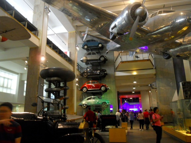 science museum, fighter plane, automobiles, cars