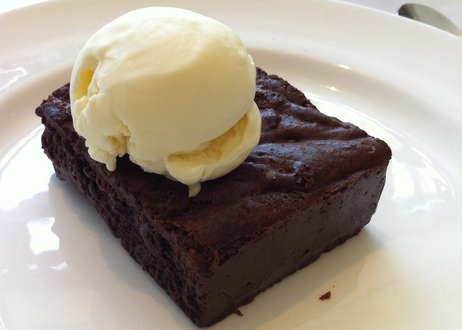 Chicago warm chocolate brownie topped with vanilla ice cream @ Marco Pierre White Steakhouse Bar & Grill