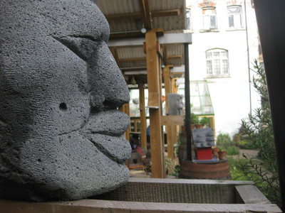 Dalston East Curve Garden face sculptures
