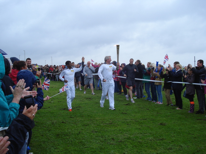Brendan Foster and Haile Gebrsalassie in the 2012 Olympic Torch Relay on The Leas at South Shields