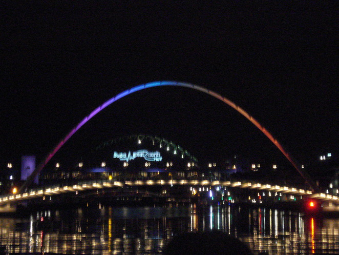The Millennium Bridge glows red as the Sage provides the backdrop