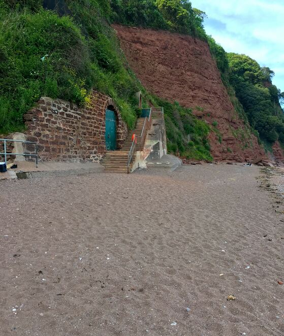 tunnel stairs,ness beach,smugglers tunnel,english seaside