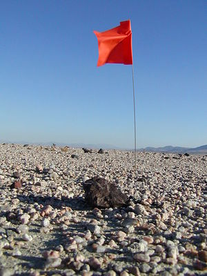 The smart meteorite brings along its own flag. Photo by Meteoritekid, Wikipedia
